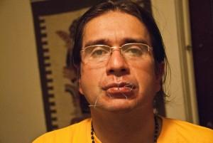 Jorge Parra with lips sewn shut